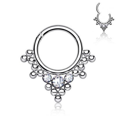 Hinged ring in titanium with clustered beads and stones