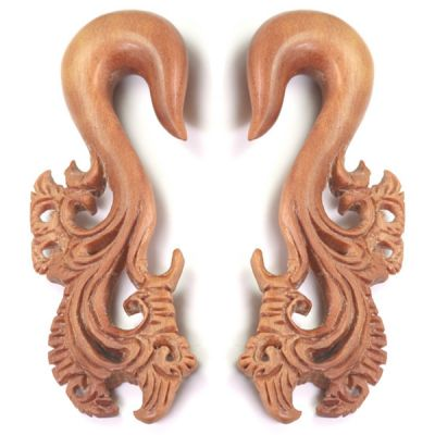 Hanger made in wood with ornamental design